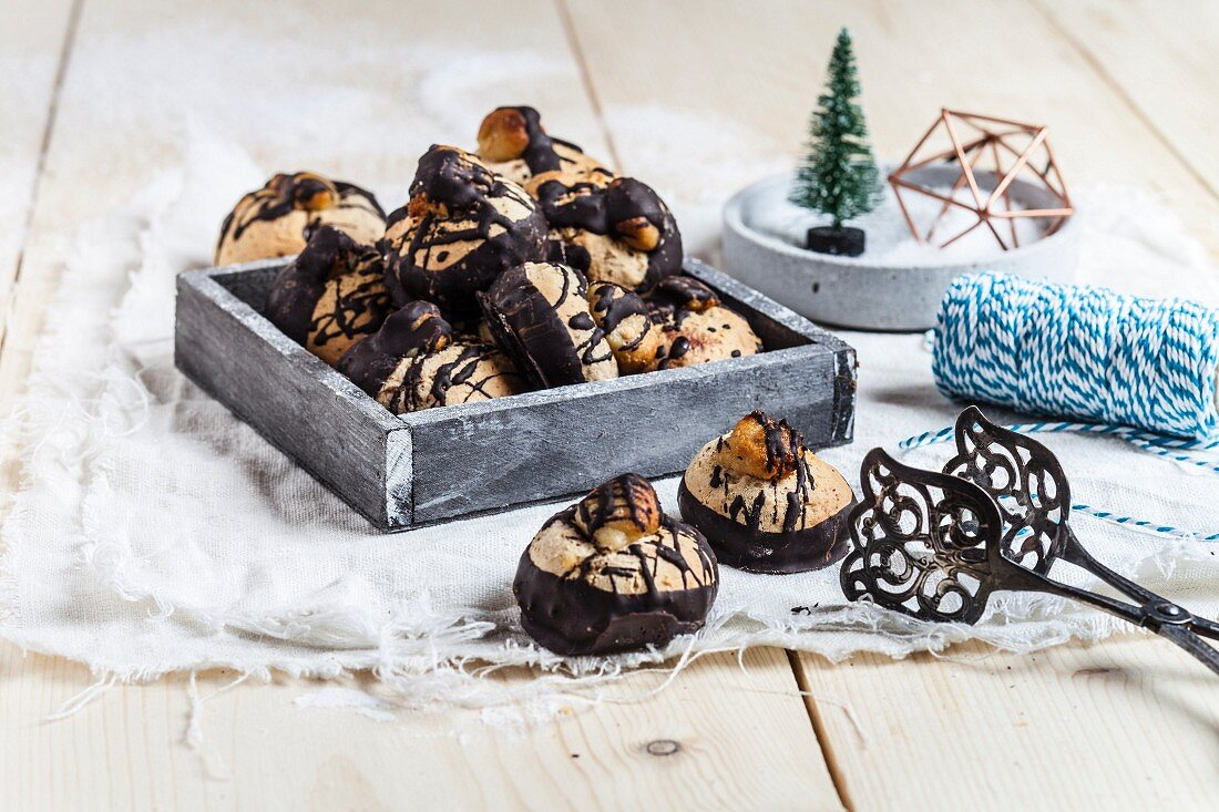 Gingerbread cookies with dark chocolate and almond paste, holiday decoration