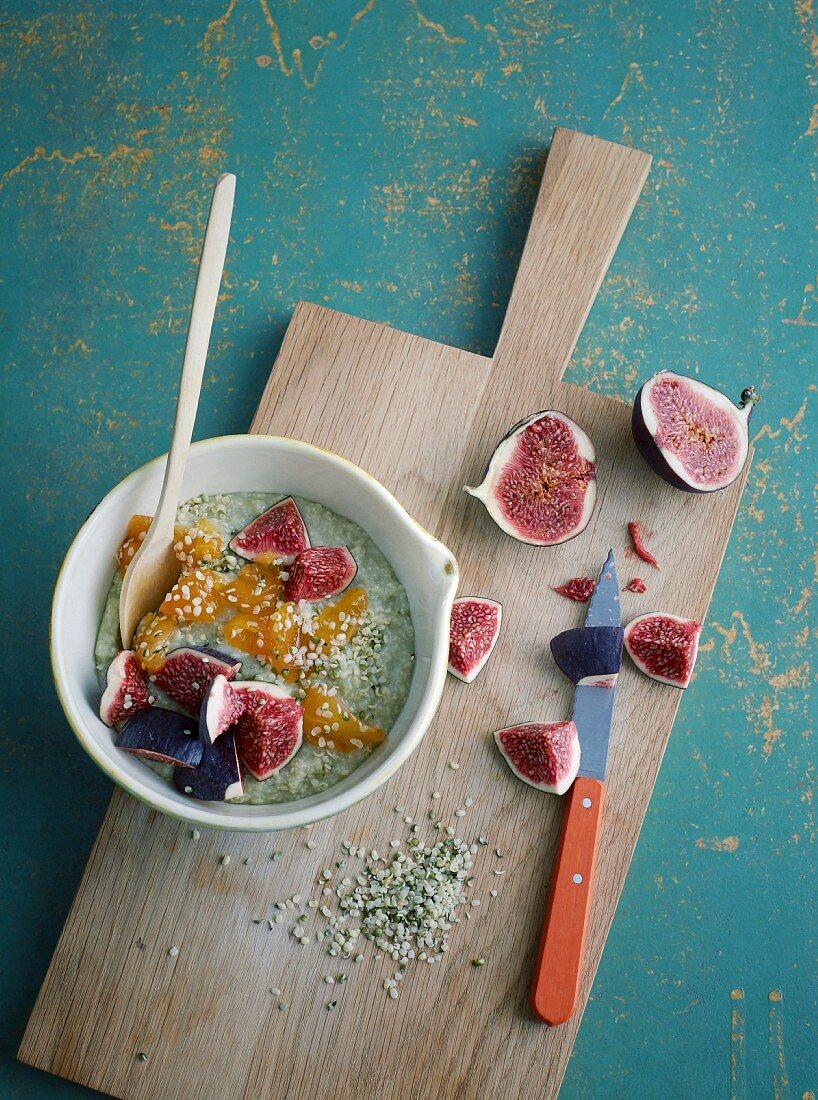 Green millet porridge with fresh figs and wheatgrass powder