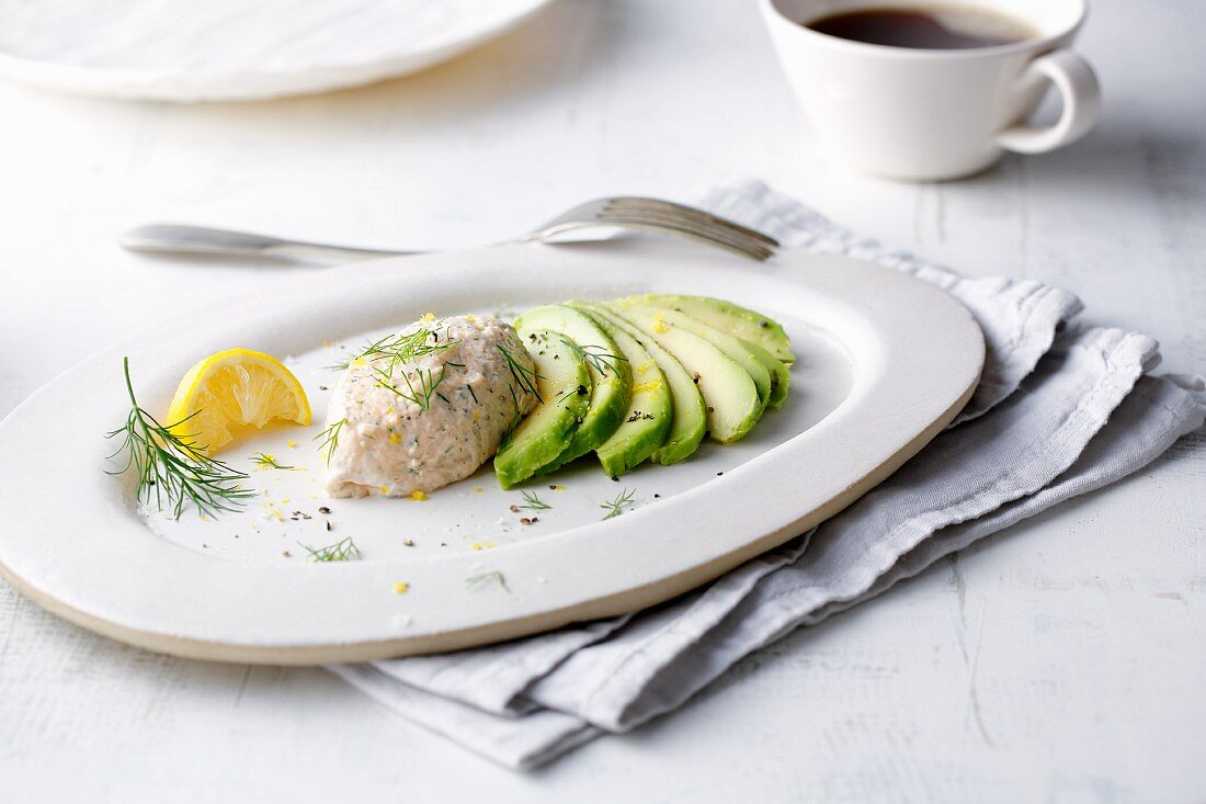 Smoked salmon mousse on fanned-out slices of avocado