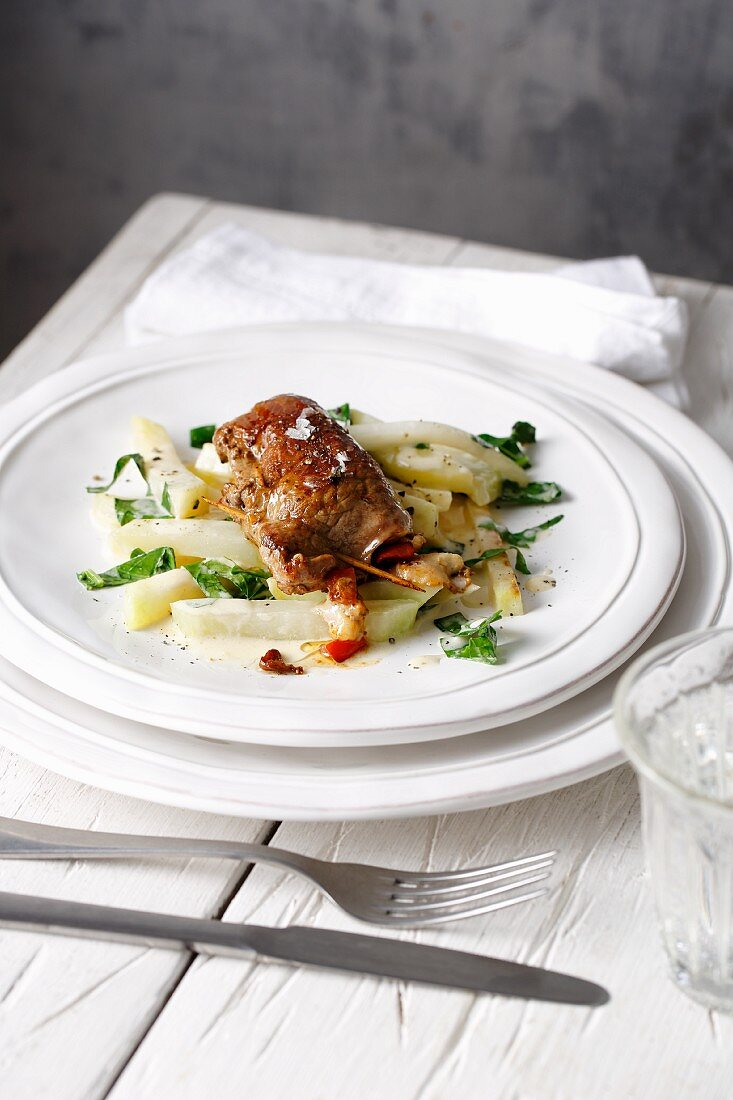 Stuffed veal schnitzel on a bed of kohlrabi