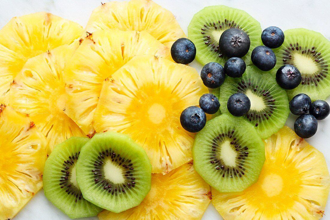 Blueberries and slices of kiwi and pineapple