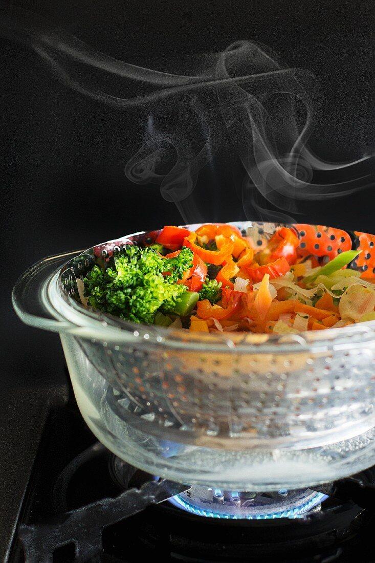 Steamed vegetables in a steamer