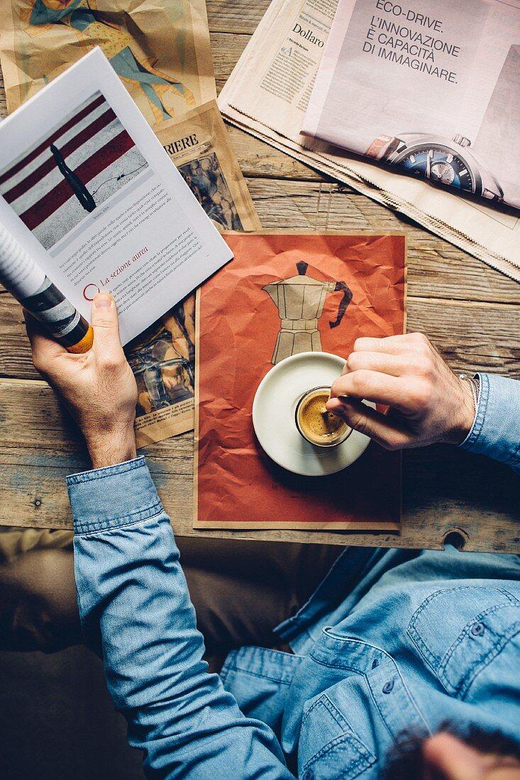 A man drinking an espresso in a café