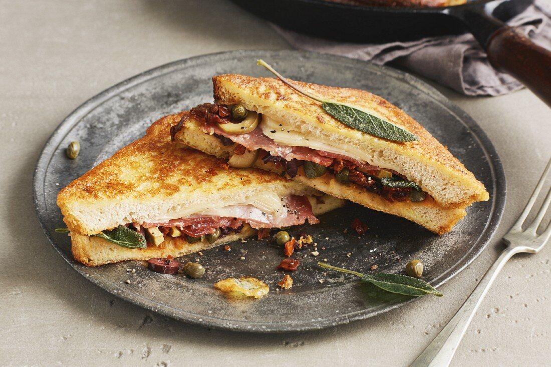 Italian-style French toast with salami, pecorino, olives, sage and sundried tomatoes