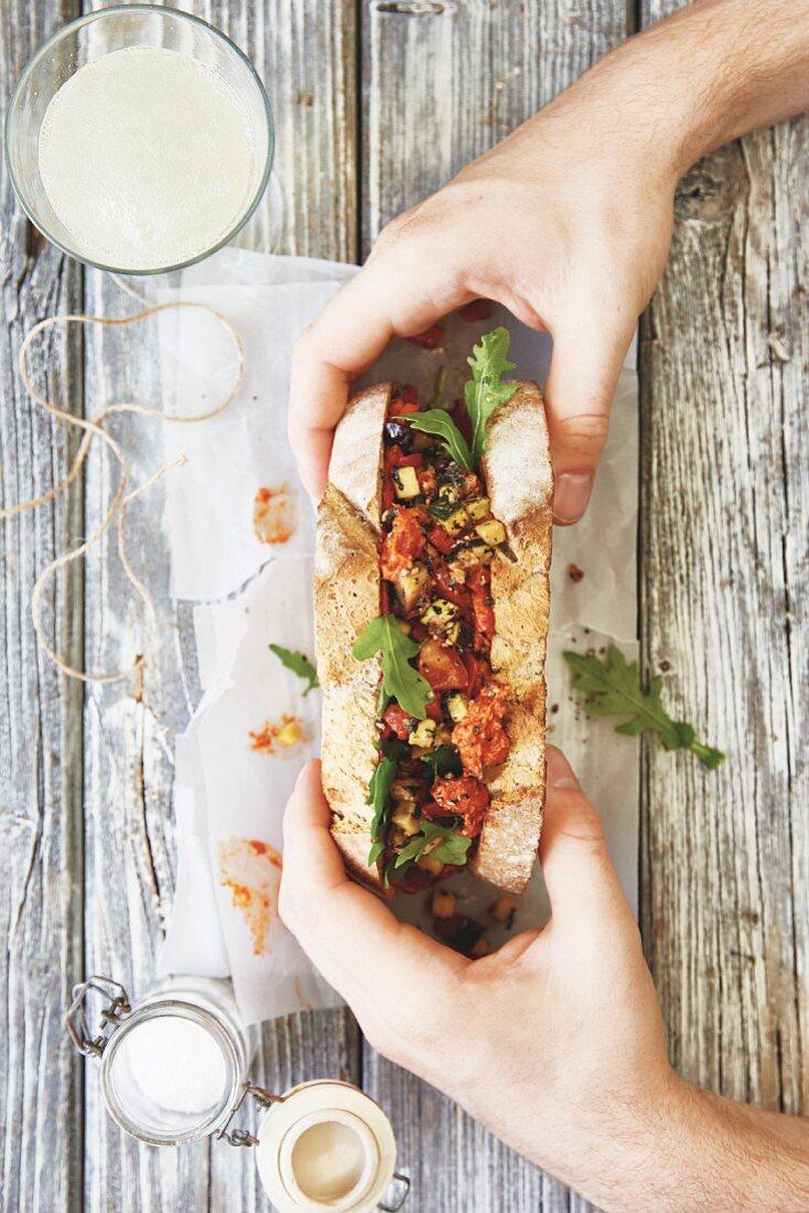 A vegan sandwich with ratatouille, cashews and rocket