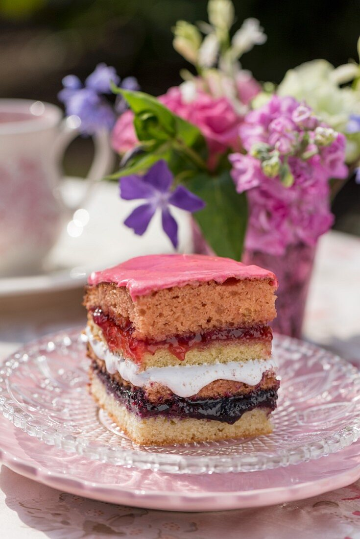 A slice of layered Battenburg sponge cake