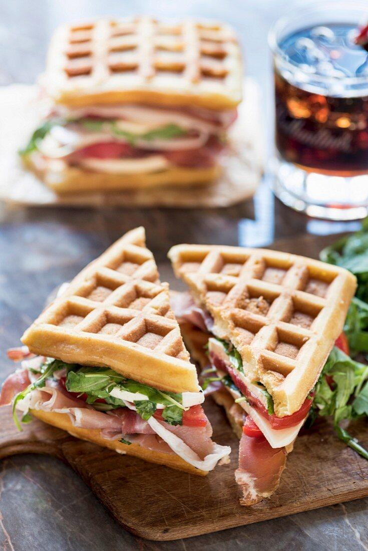 Waffle sandwich with ham, tomato, mozzarella and rocket