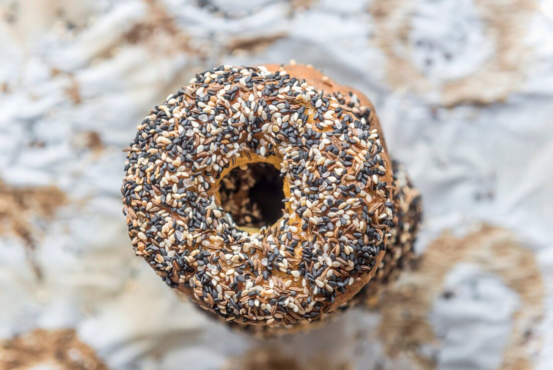 Freshly baked bagel with healthy seeds on the top