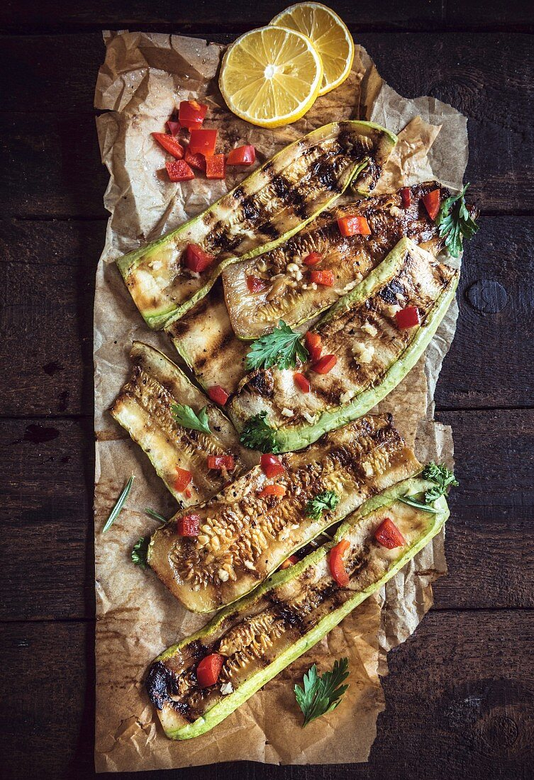 Juicy grilled zucchini with spices on the wooden table