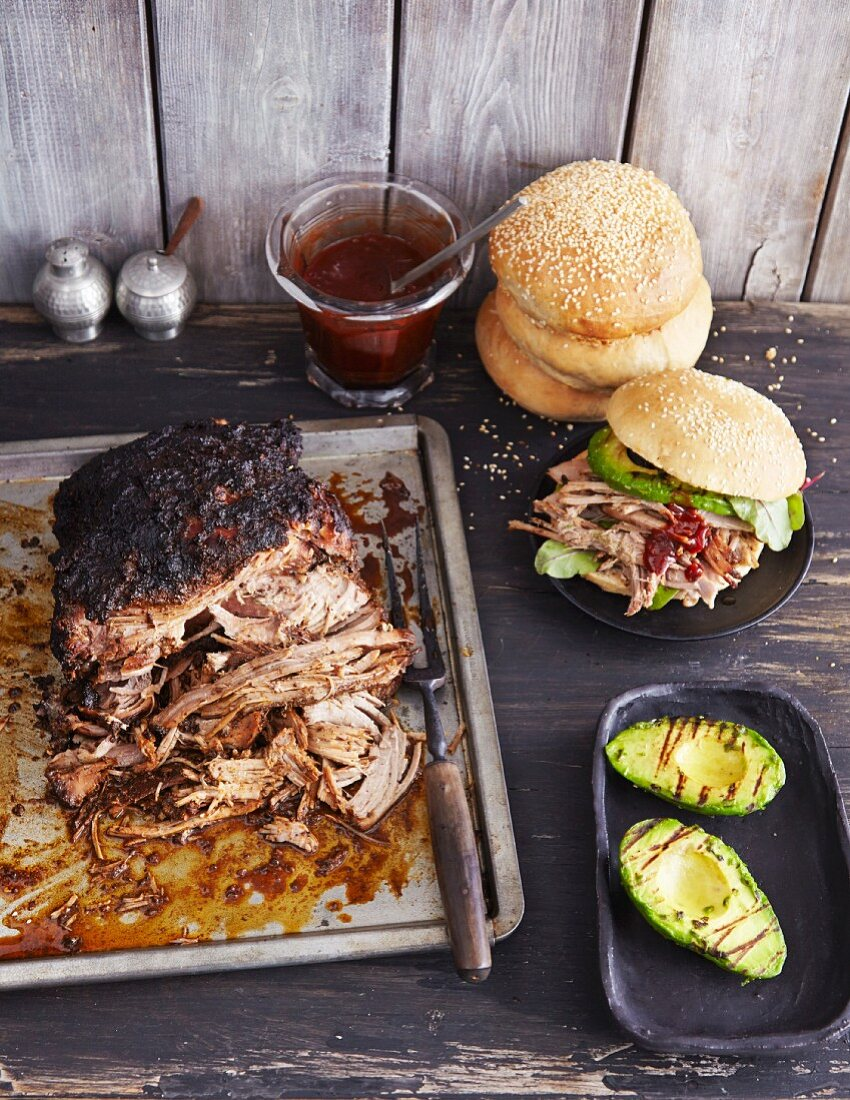 Pulled pork with apple and quince sauce and grilled avocado