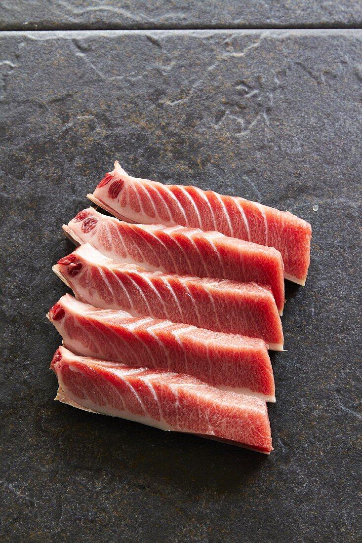 Raw tuna steaks on a grey background