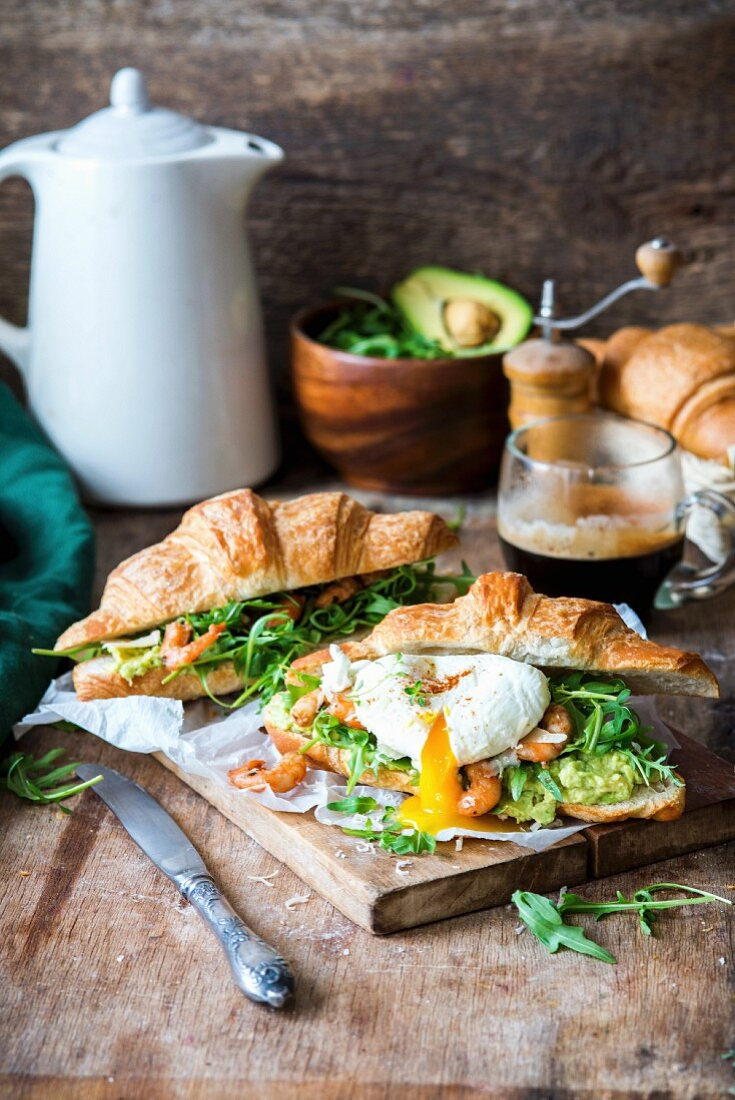 Croissants with shrimp, avocado, rocket and poached egg