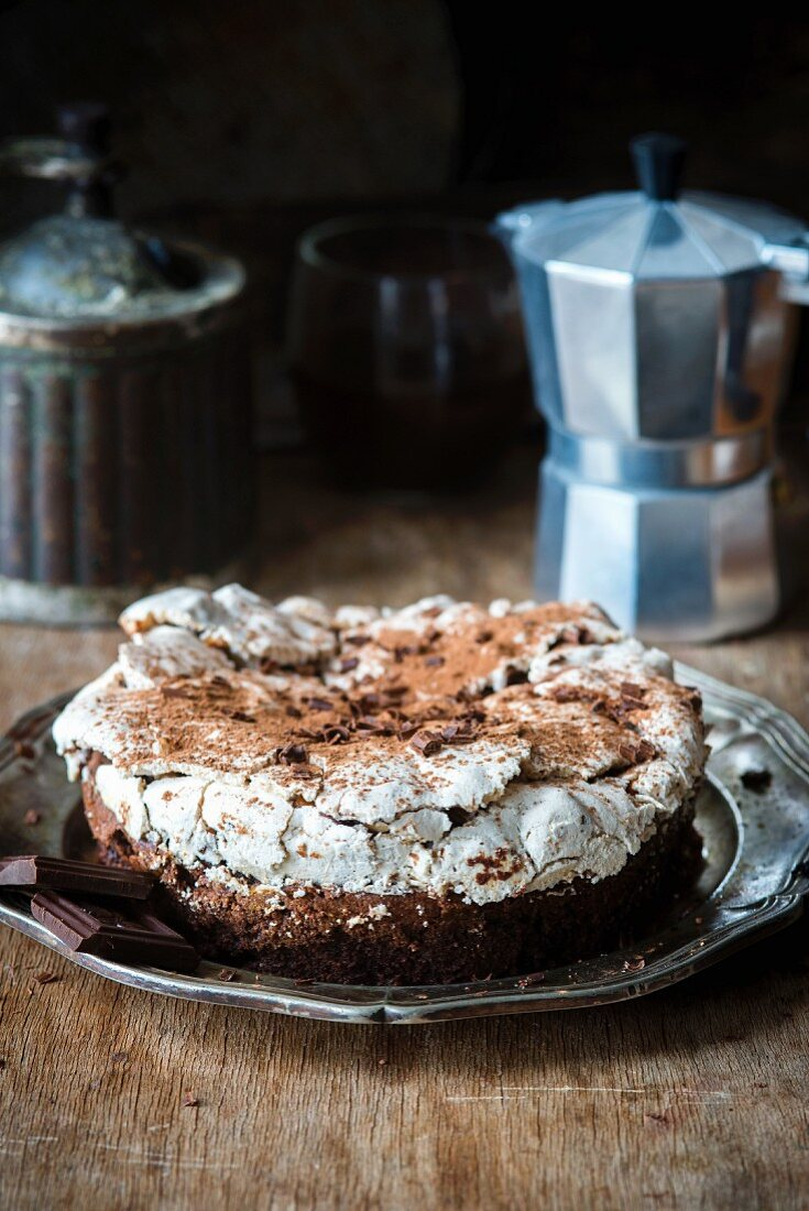 A flourless chocolate cake topped with a nut meringue