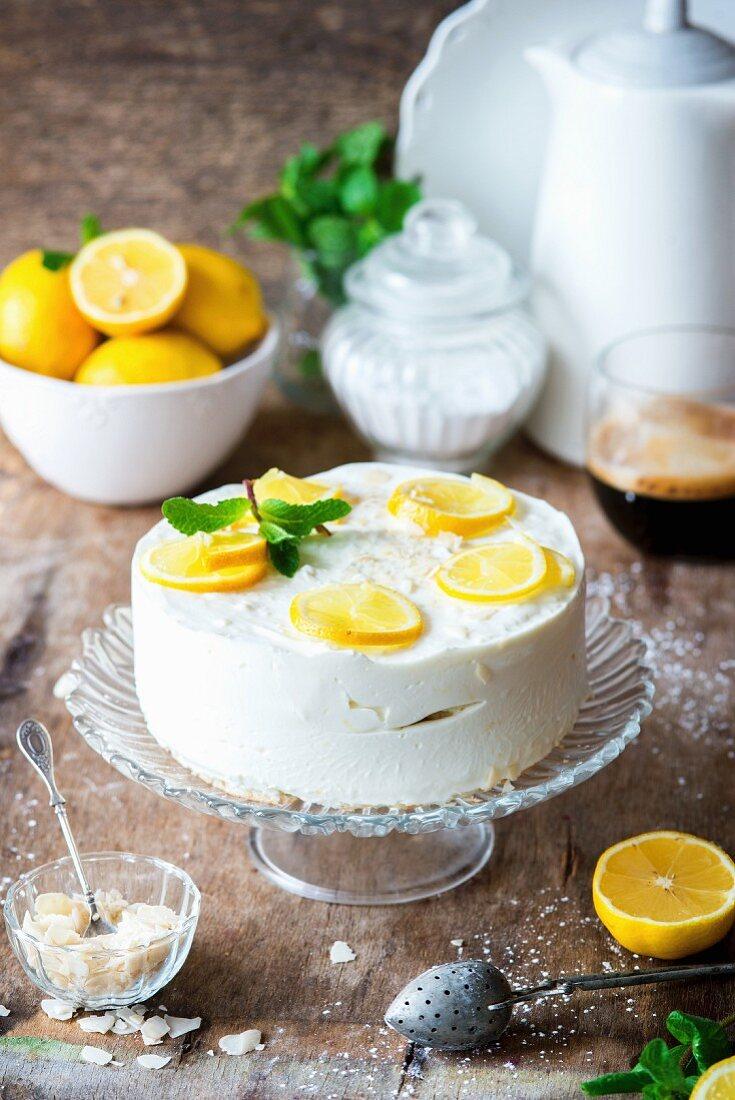 A lemon yoghurt mousse cake on a cake stand
