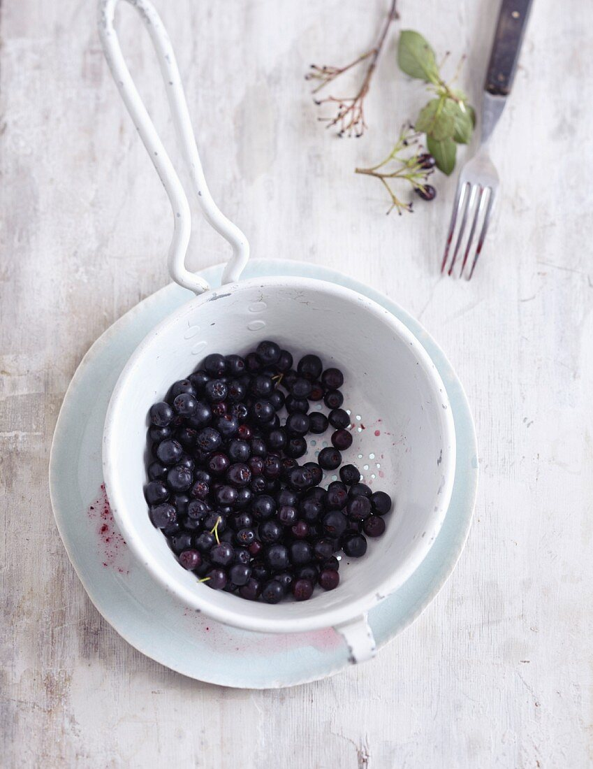 Aronia berries in a sieve
