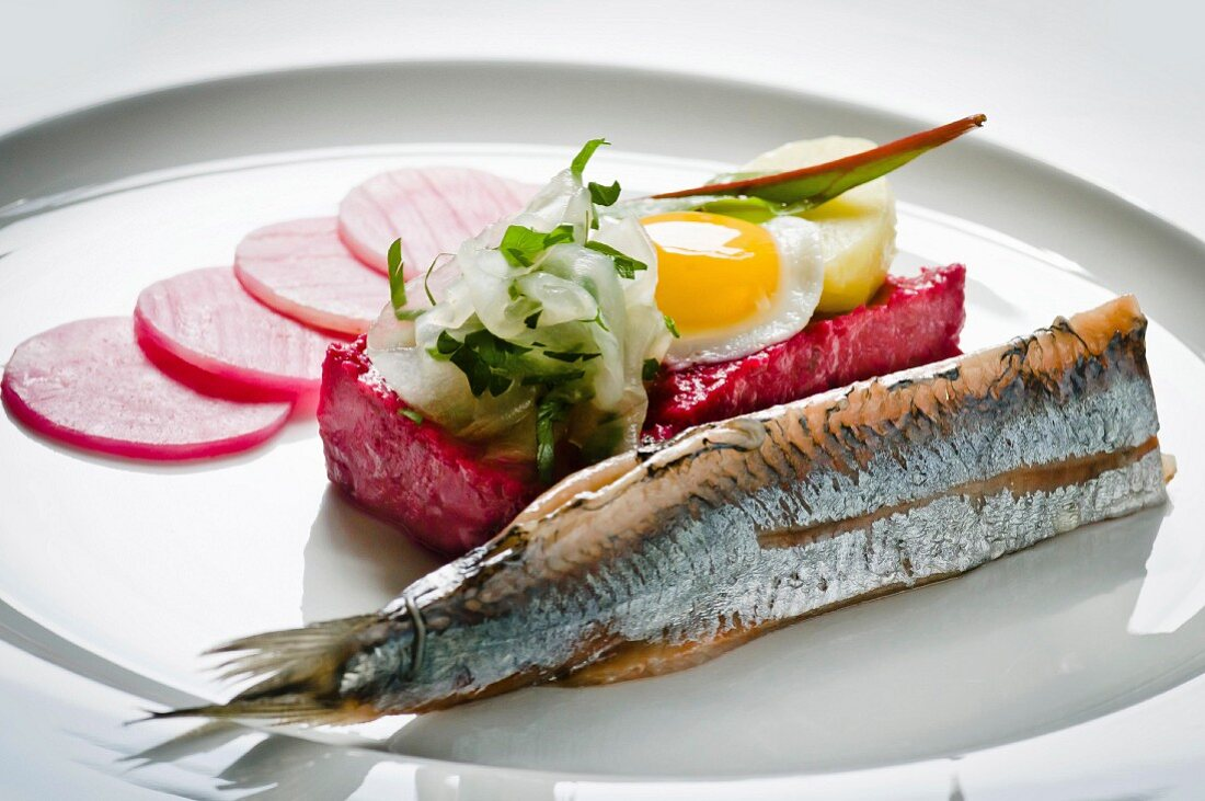 Labskaus with herring and a fried egg (Hamburg, Germany)