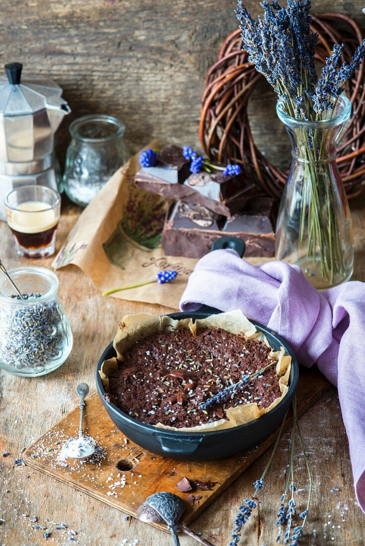 Brownies in a round baking tin with lavender sugar and salt