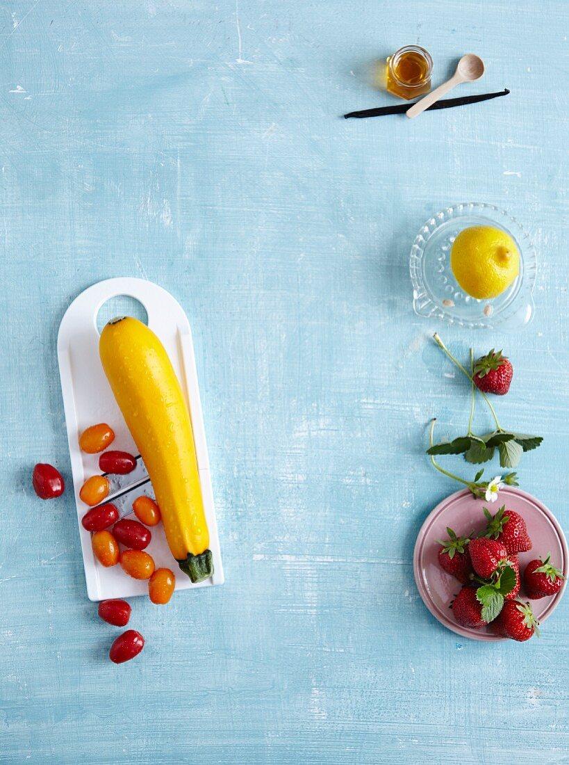 Yellow zucchini, cocktail tomatoes, and strawberries