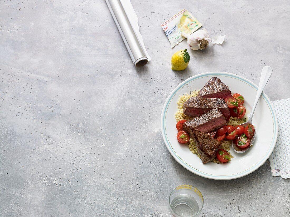 Steak with lemon couscous