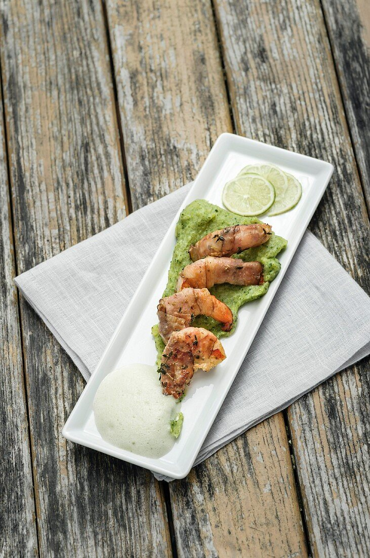Prawns on a white serving plate with potato and broccoli mousse, and fennel foam