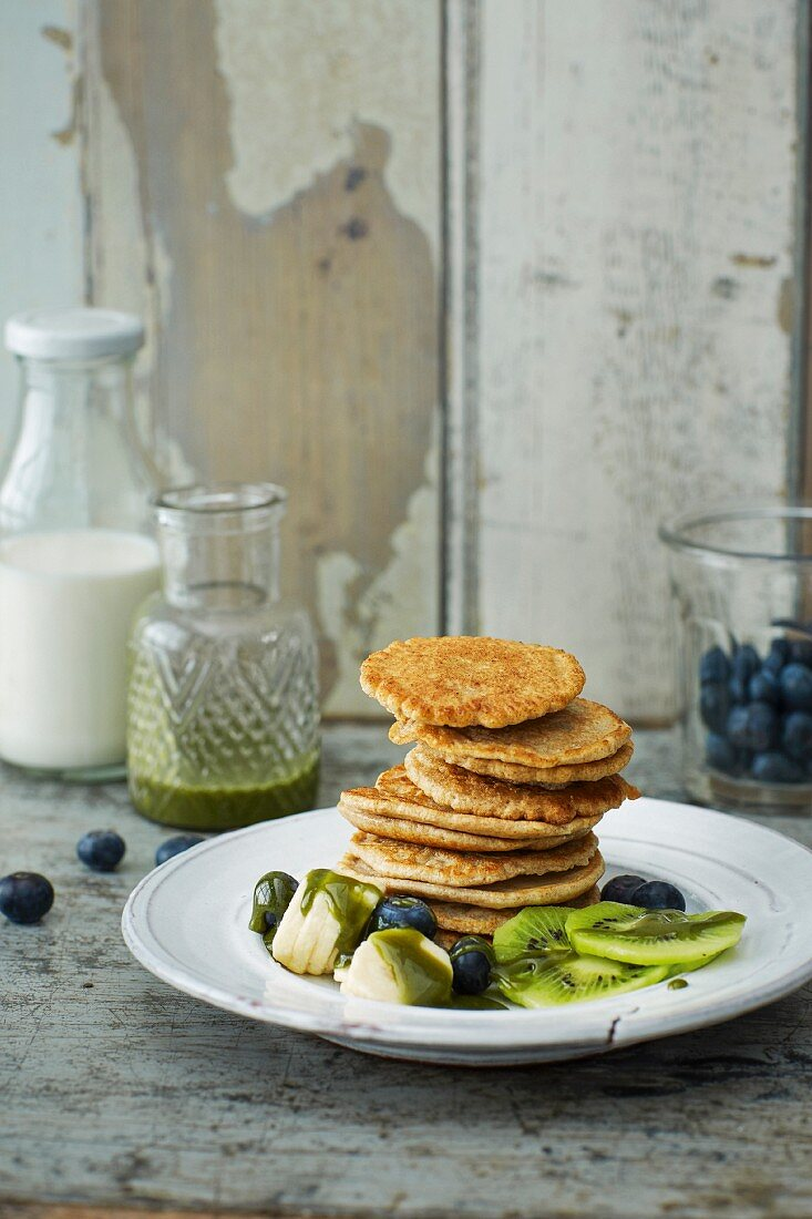 Coconut pancakes with green syrup
