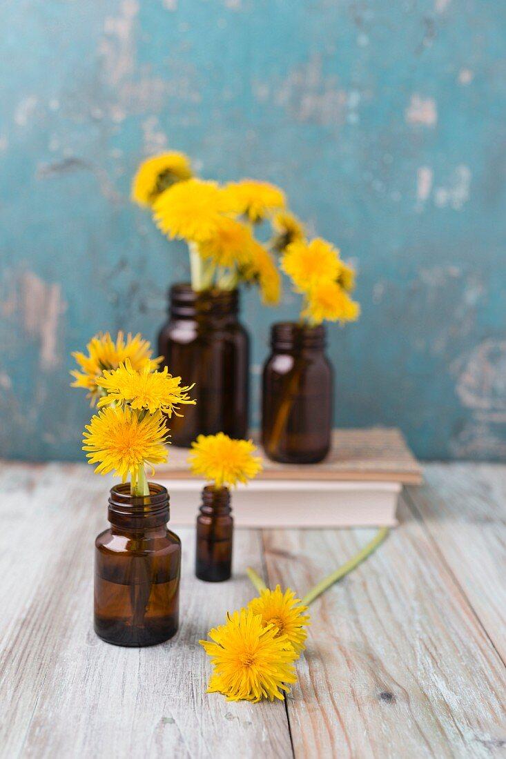 Dandelion flowers in small medicine bottles