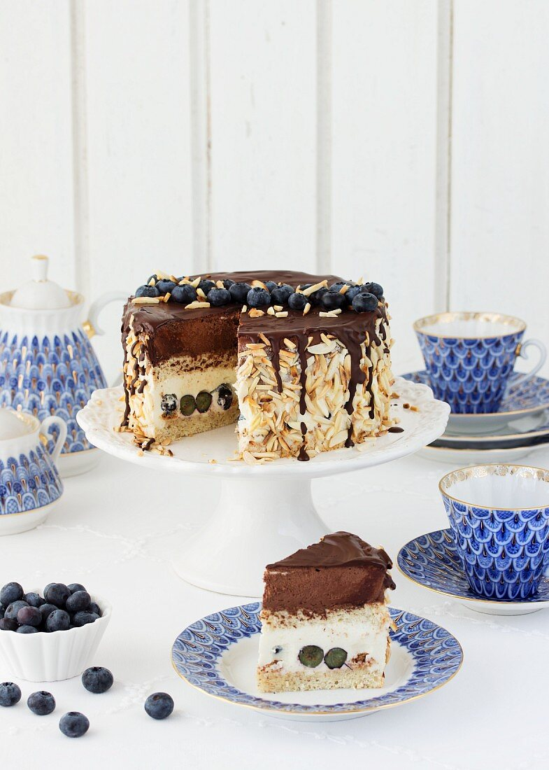 Egg liqueur chocolate cake with blueberries, sliced