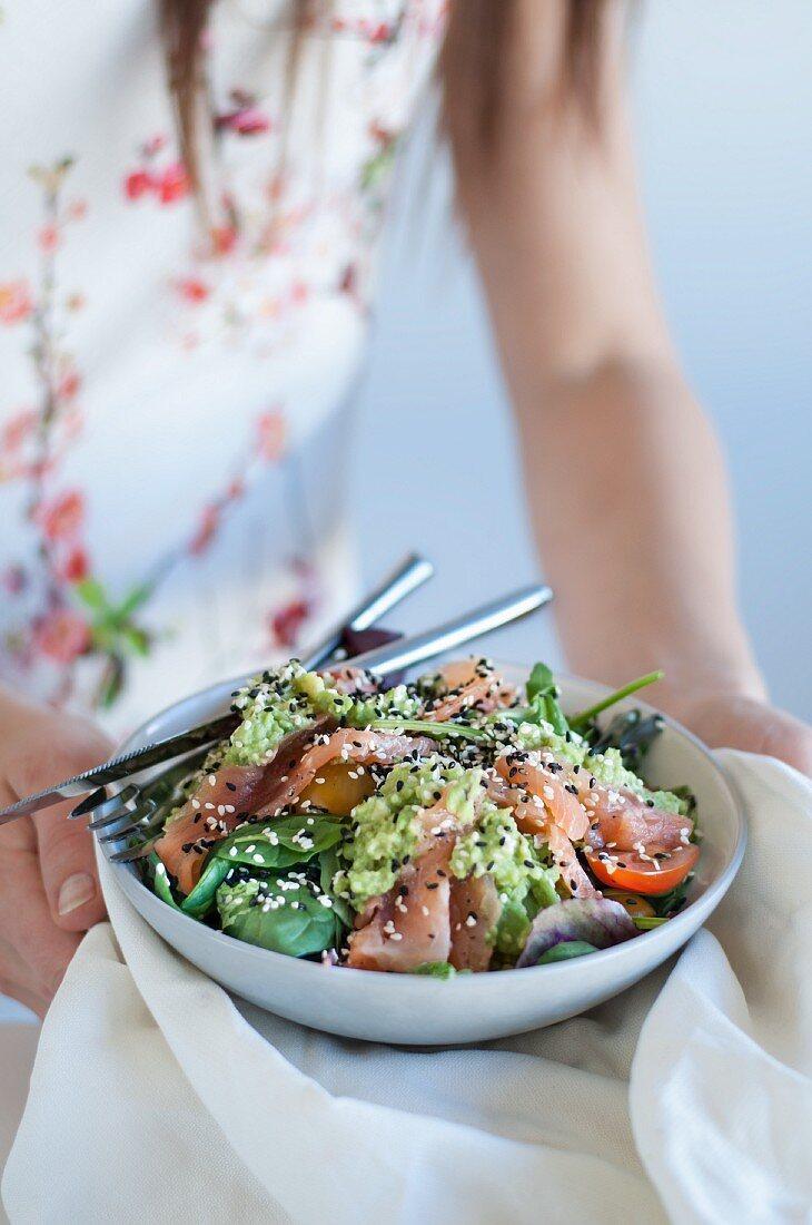 Avocado and salmon salad with sesame seeds