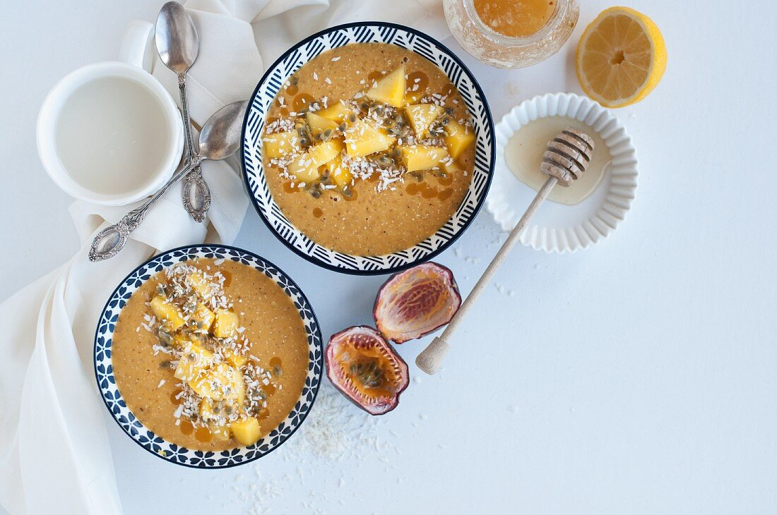 Mango and passion fruit smoothie bowls with almond milk, honey, and lemon