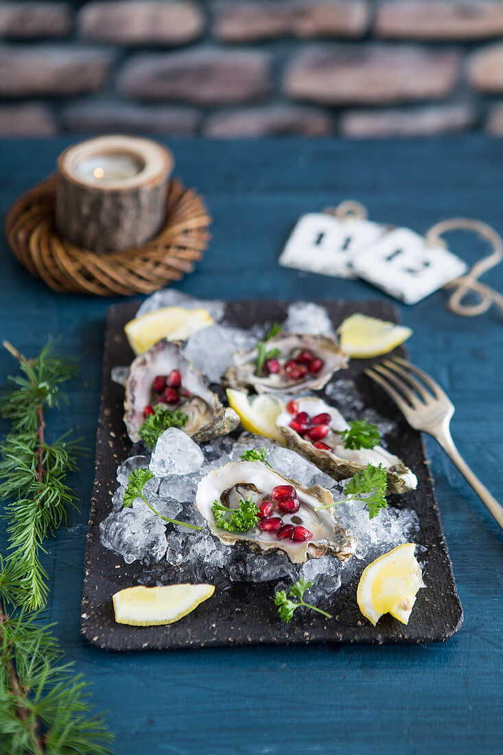 Oysters with pomegranate seeds and lemon for Christmas