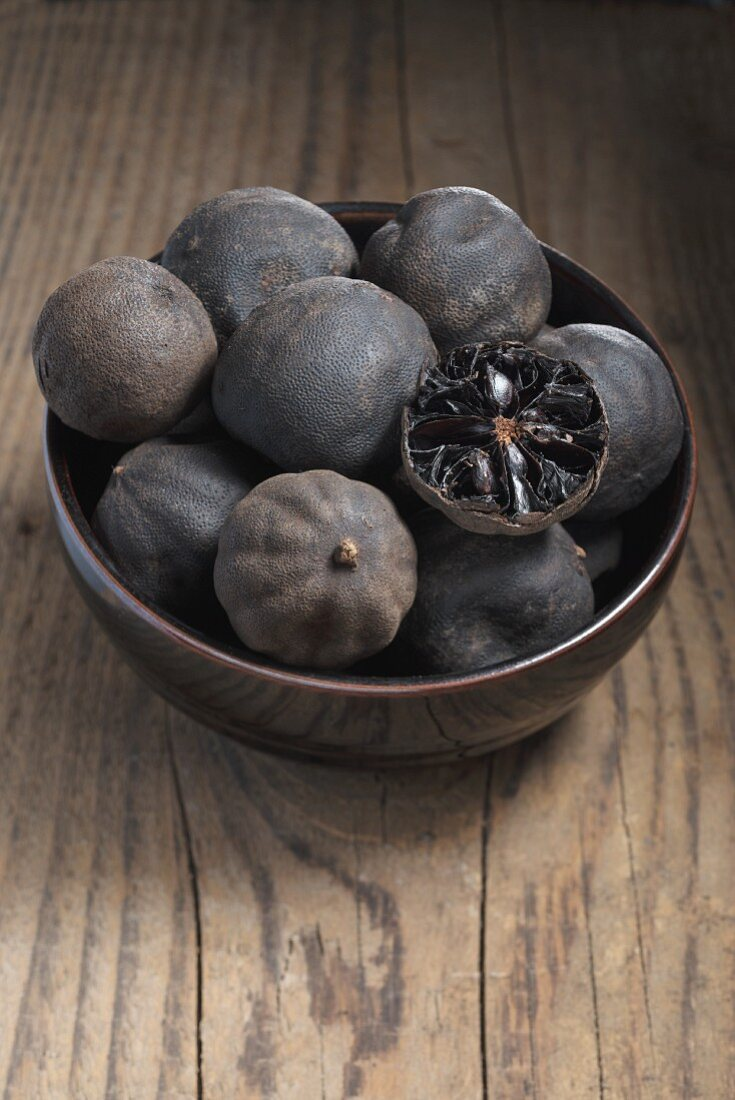 Loomi (dried limes, Middle East) in a small bowl