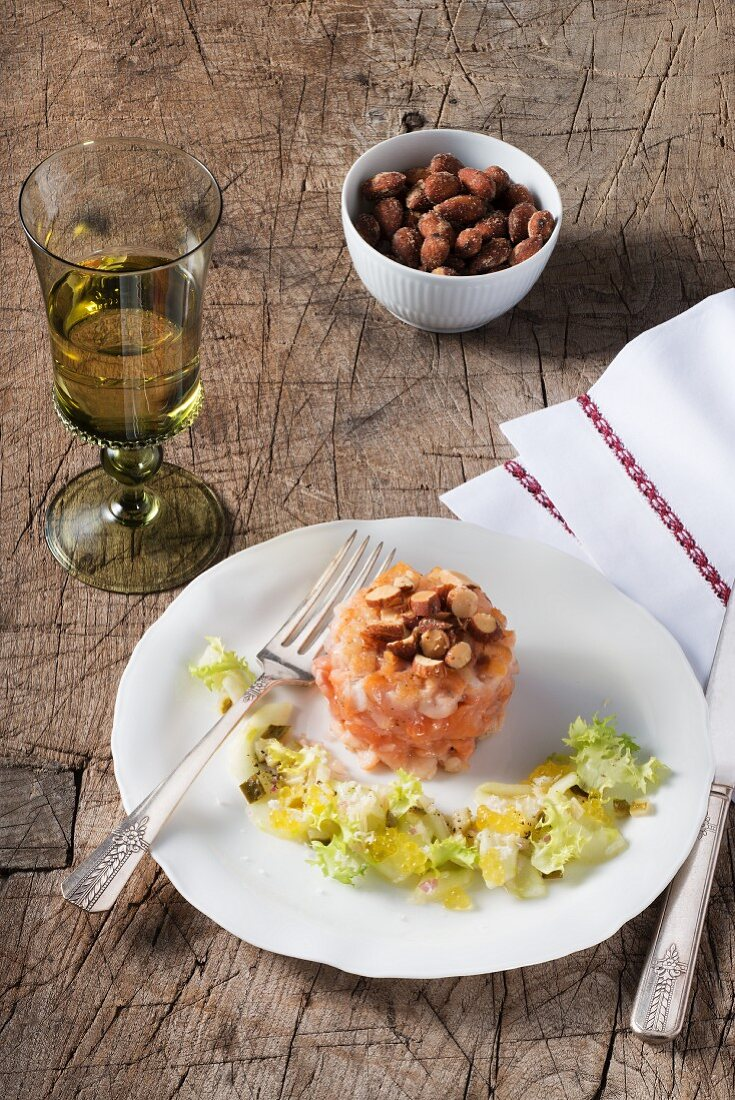 Flash fried char tartar with cucumbers, horseradish and smoked almonds