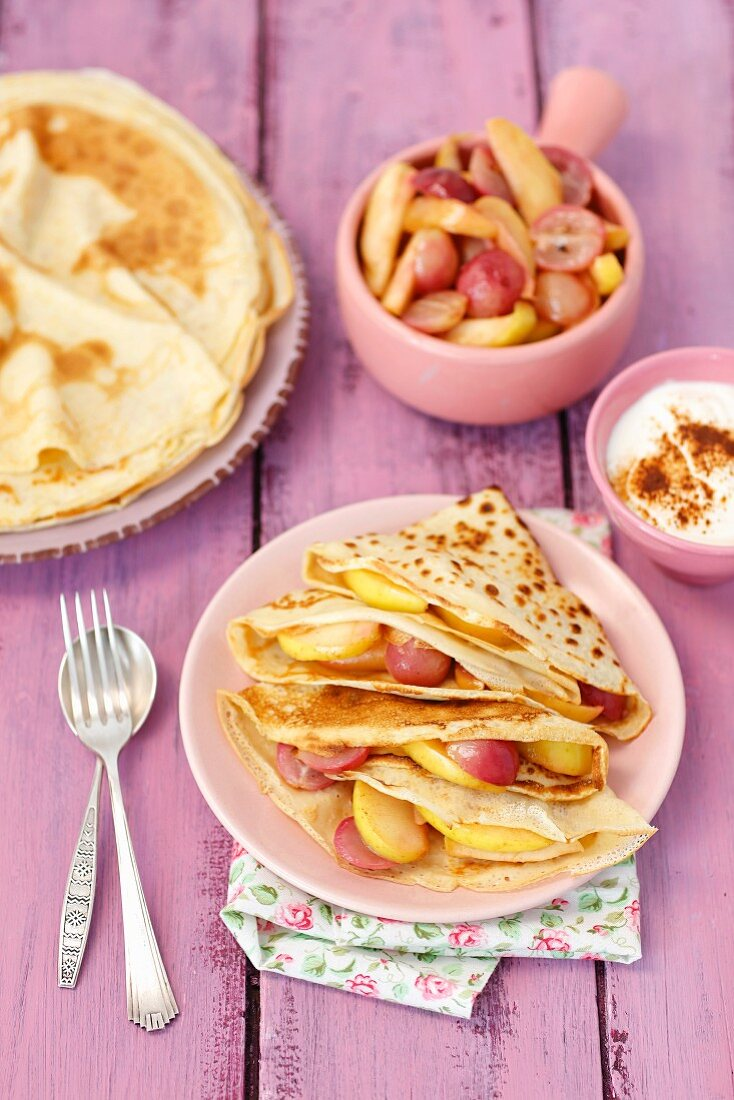 Pancakes with grapes and apple