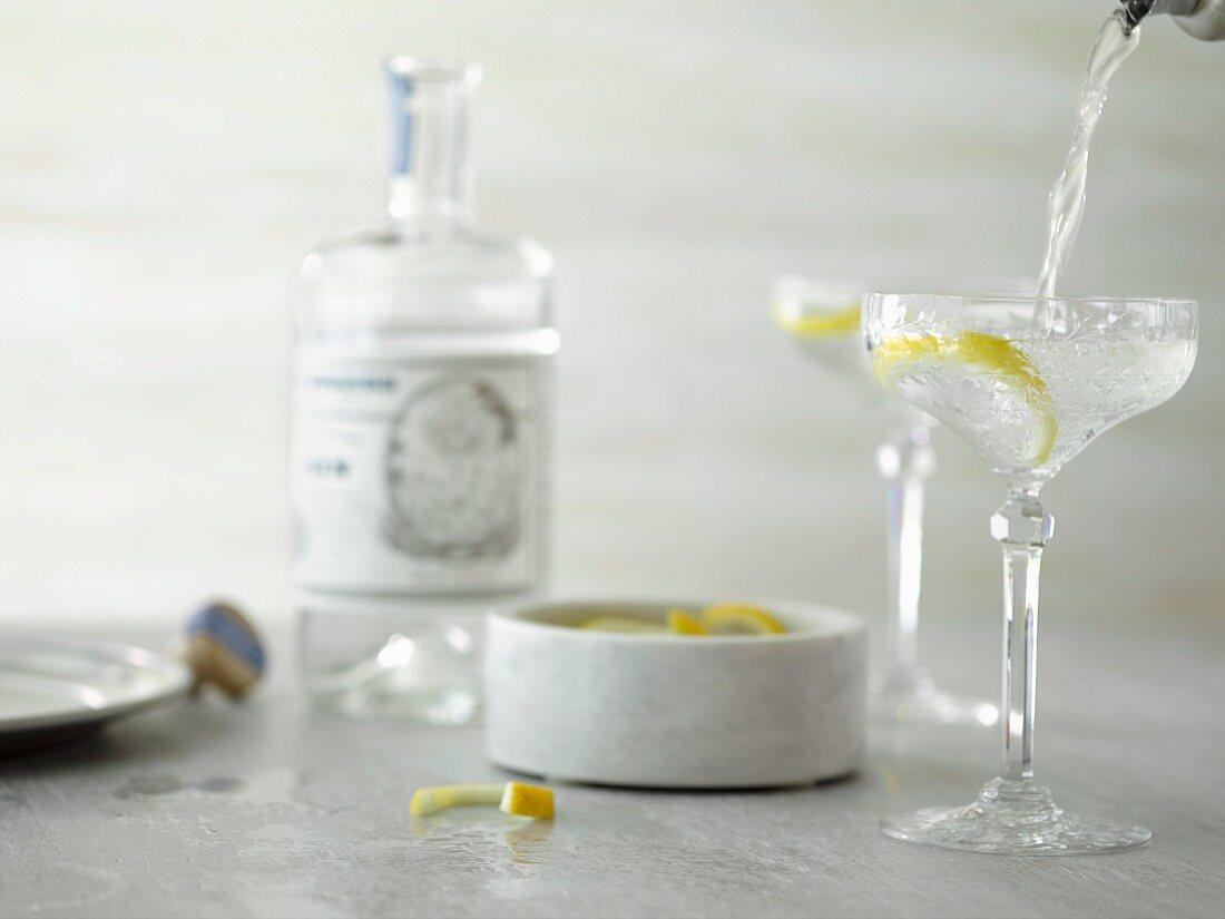 A gin martini with a lemon peel