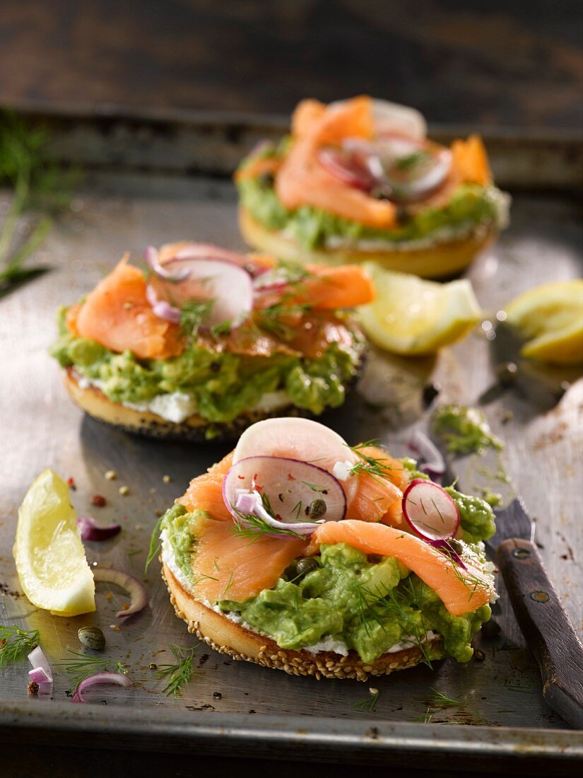 A smoked salmon bagel with avocado