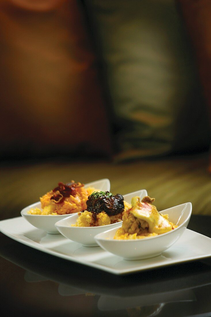 Grits Flight: stone-ground yellow grits topped with oyster and hollandaise, braised short rib and pimiento cheese with prosciutto