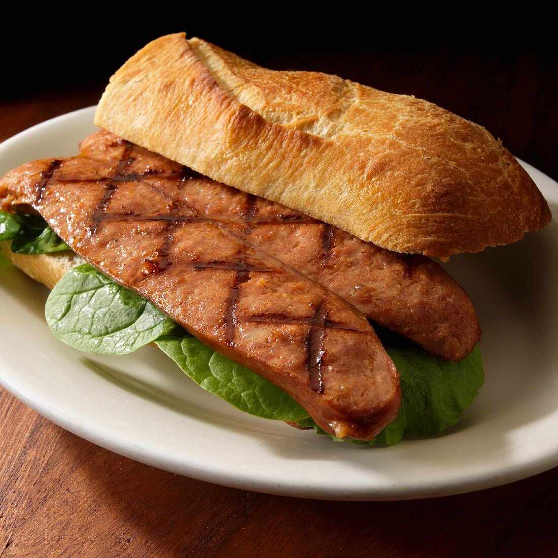 Grilled Andouille sausage sandwich on artisanal bread