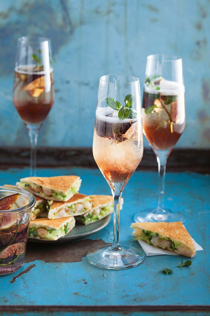 Fig prosecco with mint served with prawn tramezzini