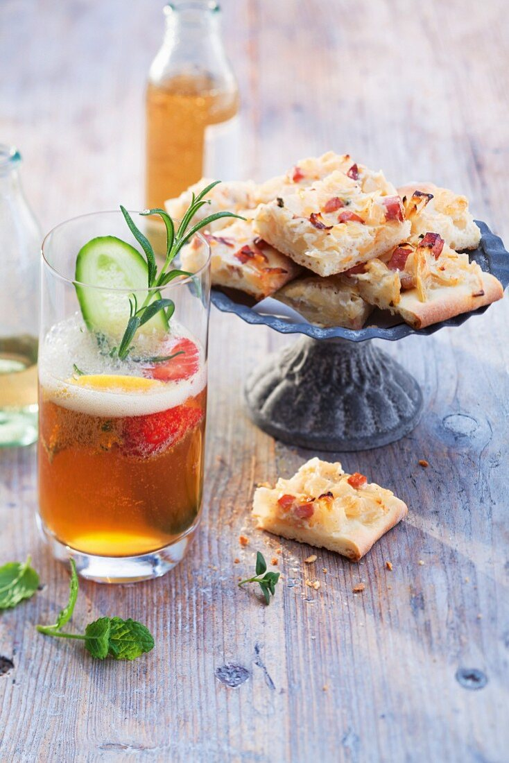 A Pimm's Cup cocktail served with onion tart