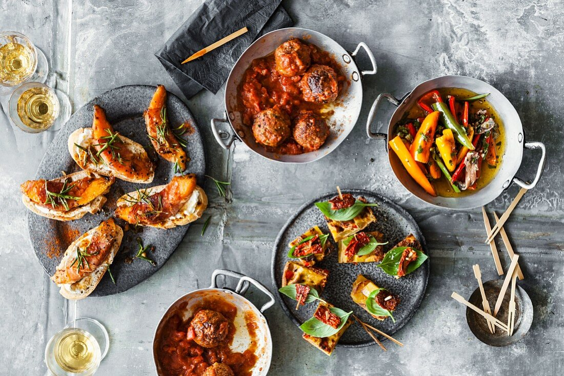 Pintxos, albondigas, tortilla picante and fried peppers with anchovies