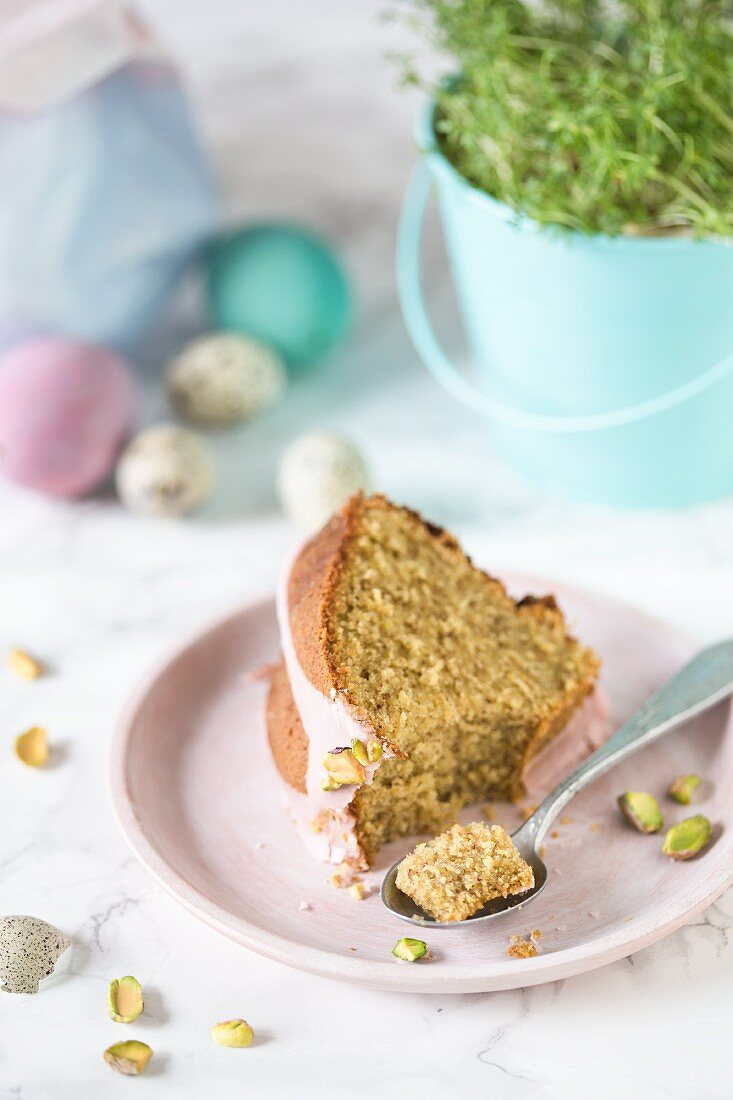 Slice of a Polish Easter cake with pistachios