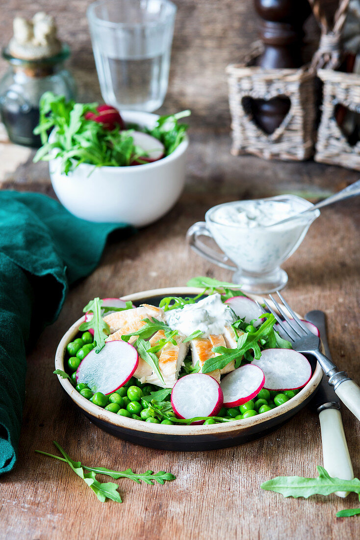 Salad with peas and radish and chicken