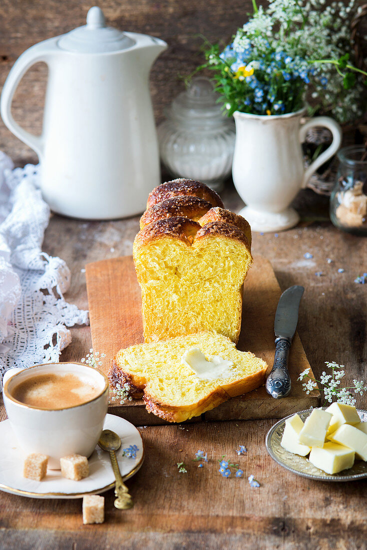 Homemade brioche, one slice with butter