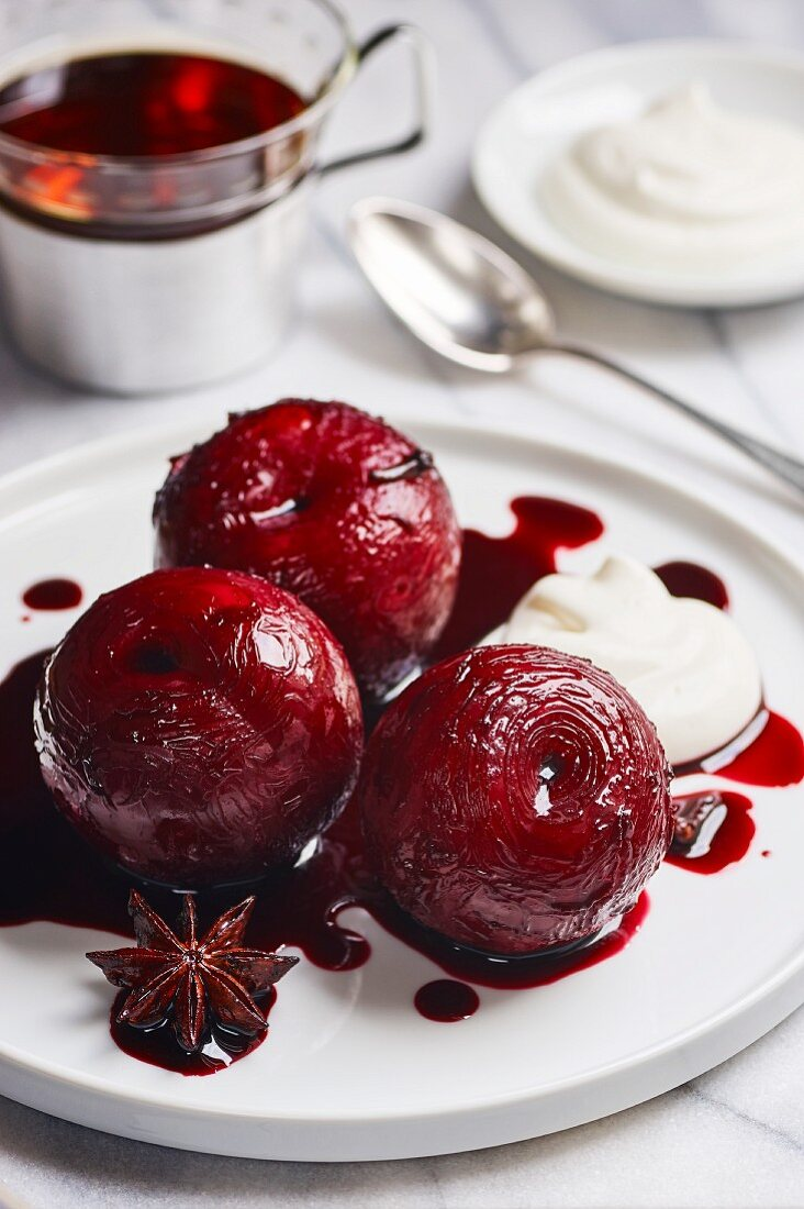 Plums poached in port wine with spices