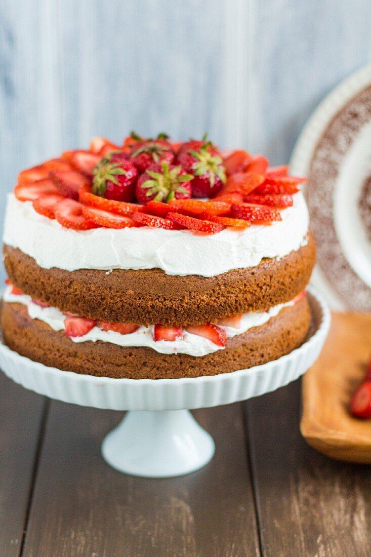 Strawberry shortcake on a cake stand