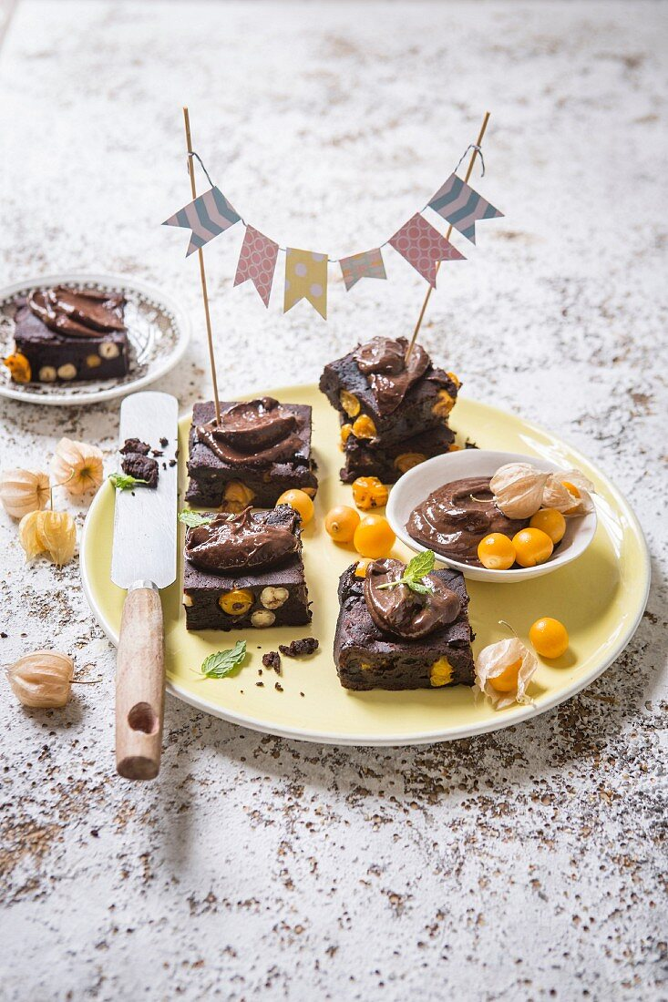 Vegan brownies with physalis and avocado and cocoa cream