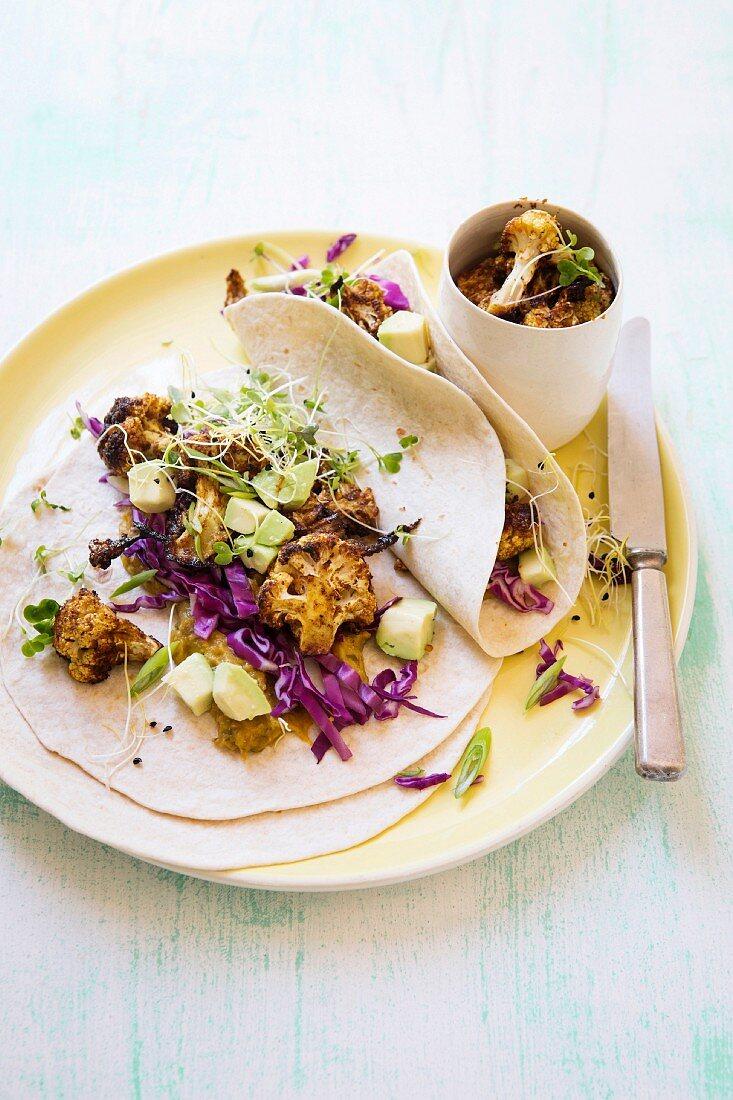 Soft tacos with roasted cauliflower, pumpkin sauce and avocado
