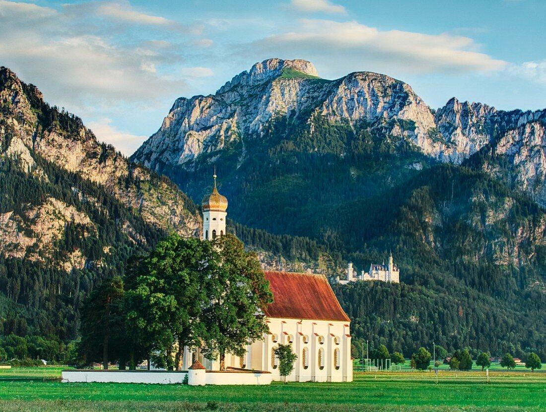 St. Coloman Church and Neuschwanstein Castle in Schwangau, Bavaria, Allgäu, Germany