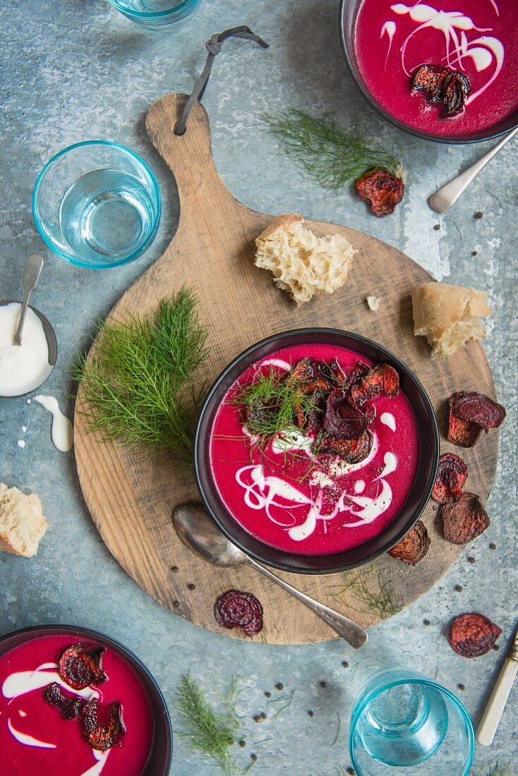 Beetroot soup with sour cream, beetroot chips and dill