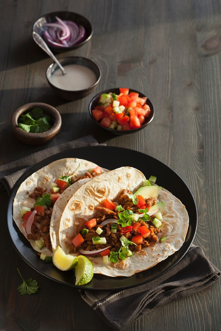 Vegan tortilla with beefy crumble from pea protein and vegetables